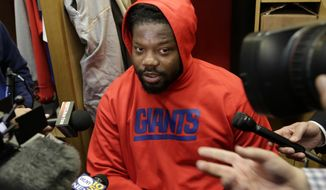 New York Giants Damon Harrison talks to reporters in the locker room after football practice in East Rutherford, N.J., Thursday, Jan. 5, 2017. (AP Photo/Seth Wenig)
