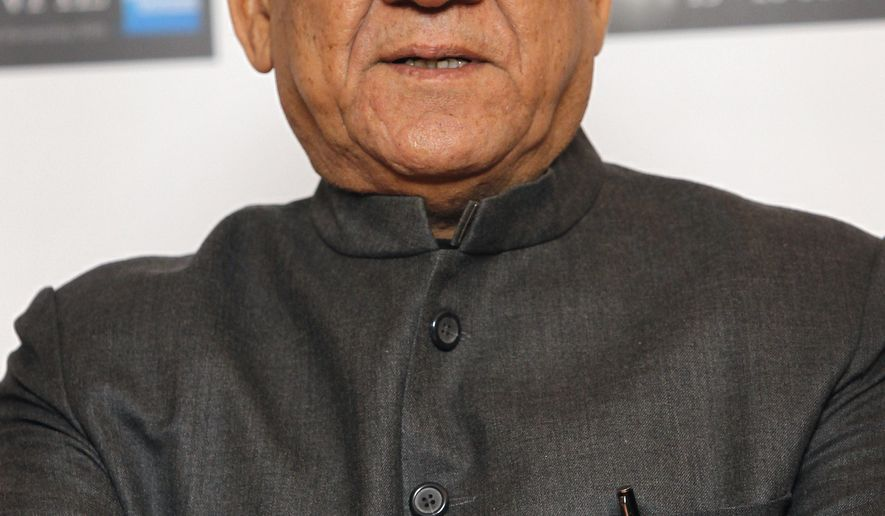 """FILE - In this Oct. 19, 2010 file photo, Indian actor Om Puri poses during a London Film Festival photocall of West is West, at a central London cinema. Noted Indian character actor Puri died in the western city of Mumbai on Friday, Jan. 6, 2017. In a career spanning more than three decades, Puri had won a slew of national awards and international fame for his work in several critically acclaimed films. He also acted in the British comedy East is East, about the life of a Pakistani immigrant in England and had a small role in Richard Attenborough's film """"Gandhi,"""" based on the life of the Indian freedom leader Mohandas Gandhi. (AP Photo/Joel Ryan, File)"""