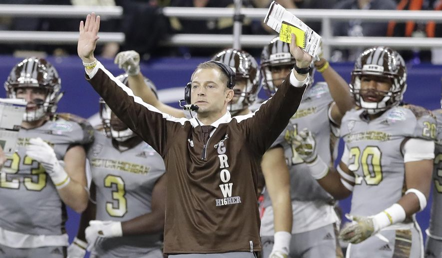 FILE - In this Dec. 2, 2016, file photo, Western Michigan head coach P.J. Fleck signals during the first half of the Mid-American Conference championship NCAA college football game against Ohio, in Detroit. Fleck is leaving Western Michigan and heading to Minnesota to coach its reeling football team. Western Michigan announced Friday, Jan. 6, 2017, that Fleck informed the school of his decision. (AP Photo/Carlos Osorio, File)