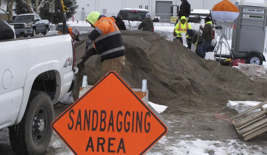 City crews help local business owners fill sandbags in the Sparks Industrial Park in Sparks, Nev., Friday, Jan. 6, 2017 within a mile of the Truckee River, which is expected to experience its worst flooding this weekend in more than a decade. The mayor of the city neighboring Reno has declared a state of emergency as warmer, wet storm is expected to hit on the heels of a colder one that dumped more than 6 feet of snow on the stop of the Sierra over the past week. (AP Photo/Scott Sonner)