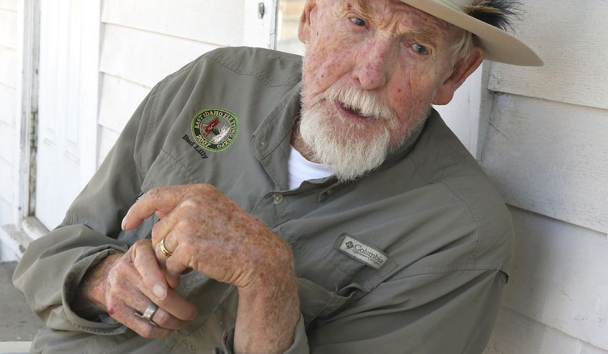 FILE - In this July 23, 2015, file photo, Bud Lilly sits on his porch in Three Forks, Mont. The fly fishing legend, conservationist and catch-and-release pioneer Lilly has died of congestive heart failure at a Montana care center on Wednesday, Jan. 4, 2017, according to his son. He was 91. (Walter Hinick/The Montana Standard via AP, File)