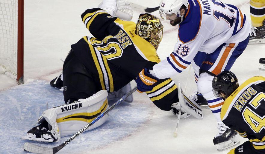 Edmonton Oilers left wing Patrick Maroon (19) scores past Boston Bruins goalie Tuukka Rask (40) in the third period of an NHL hockey game, Thursday, Jan. 5, 2017, in Boston. It was Maroon's third goal of the game. (AP Photo/Elise Amendola)