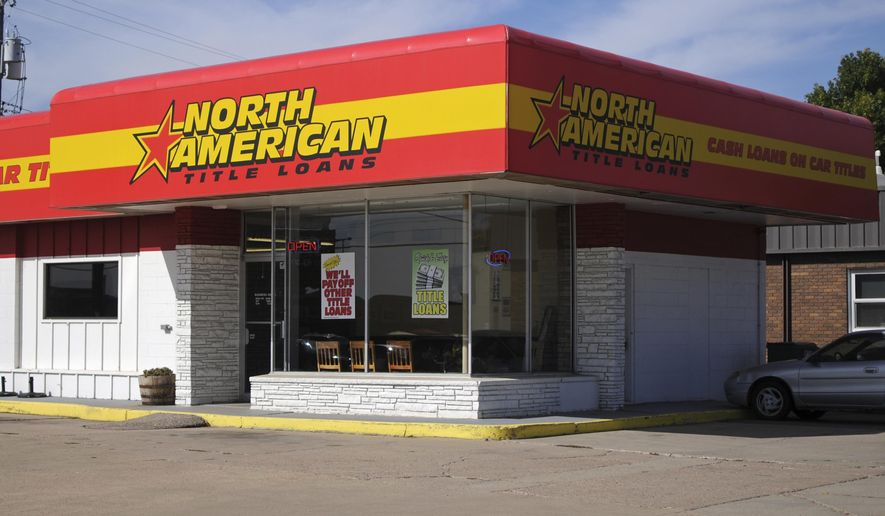 This Sept. 30, 2016, photo, shows a North American Title Loans location in Sioux Falls, S.D. Nearly half of South Dakota's short-term lenders didn't renew their state licenses for 2017 after voters capped the interest rates the businesses can charge. North American is among lenders that renewed their licenses but aren't offering new loans. (AP Photo/James Nord)
