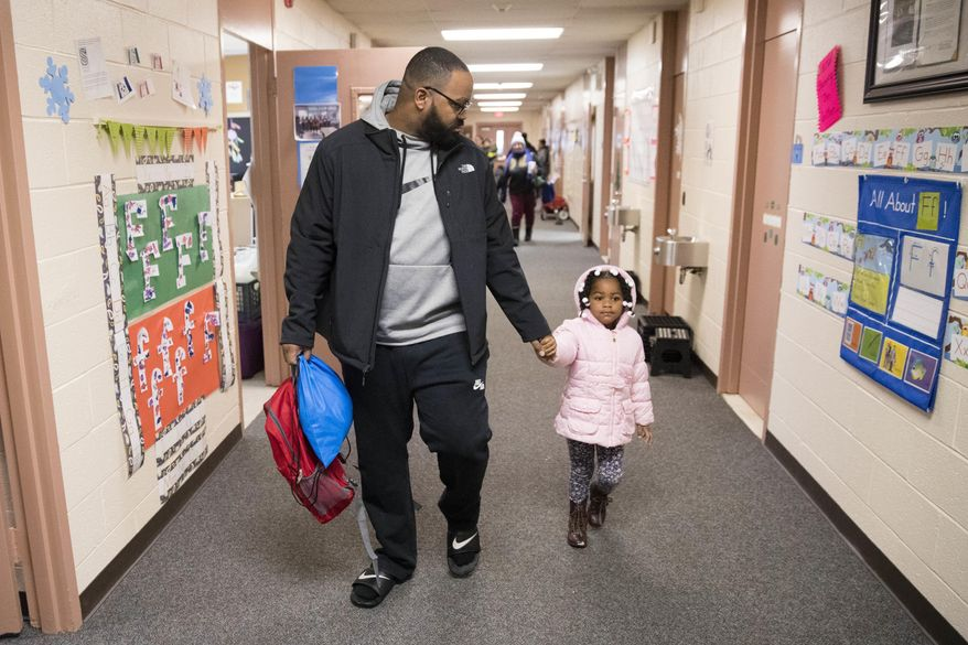 Eric Grant takes his three-year-old daughter Makayla to preschool in Philadelphia, Friday, Jan. 6, 2017. Thousands of Philadelphia toddlers are starting 2017 in a city pre-kindergarten program, launched this week alongside a new sugary beverage tax created to fund it.   (AP Photo/Matt Rourke)