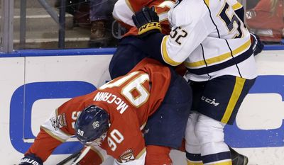 Nashville Predators defenseman Matt Irwin (52) collides with Florida Panthers center Jared McCann (90) and Colton Sceviour during the second period of an NHL hockey game, Friday, Jan. 6, 2017, in Sunrise, Fla. (AP Photo/Alan Diaz)