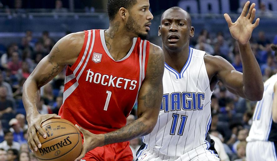 Houston Rockets' Trevor Ariza (1) looks to pass the ball around Orlando Magic's Bismack Biyombo (11) during the first half of an NBA basketball game, Friday, Jan. 6, 2017, in Orlando, Fla. (AP Photo/John Raoux)