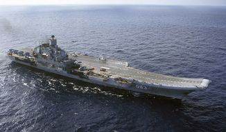 FILE - In this 2004 file photo the Admiral Kuznetsov carrier sails in the Barents Sea, Russia. Russia says it is withdrawing the Admiral Kuznetsov aircraft carrier and some other warships from the waters off Syria as the first step in drawing down forces in Syria. (AP Photo, file)