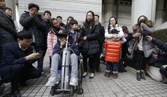 Victims and their families of toxic humidifier disinfectants hold a press conference against a court's sentence at the Seoul Central District Court in Seoul, South Korea, Friday, Jan. 6, 2017. A South Korean court has sentenced the former head of Oxy Reckitt Benckiser to seven years in prison after the company's disinfectant for humidifiers killed scores of people. (AP Photo/Ahn Young-joon)