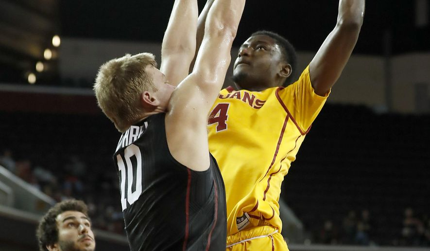 Southern California's Chimezie Metu, right, shoots over Stanford's Michael Humphrey, left, during the first half of an NCAA college basketball game Thursday, Jan. 5, 2017, in Los Angeles. (AP Photo/Ryan Kang)