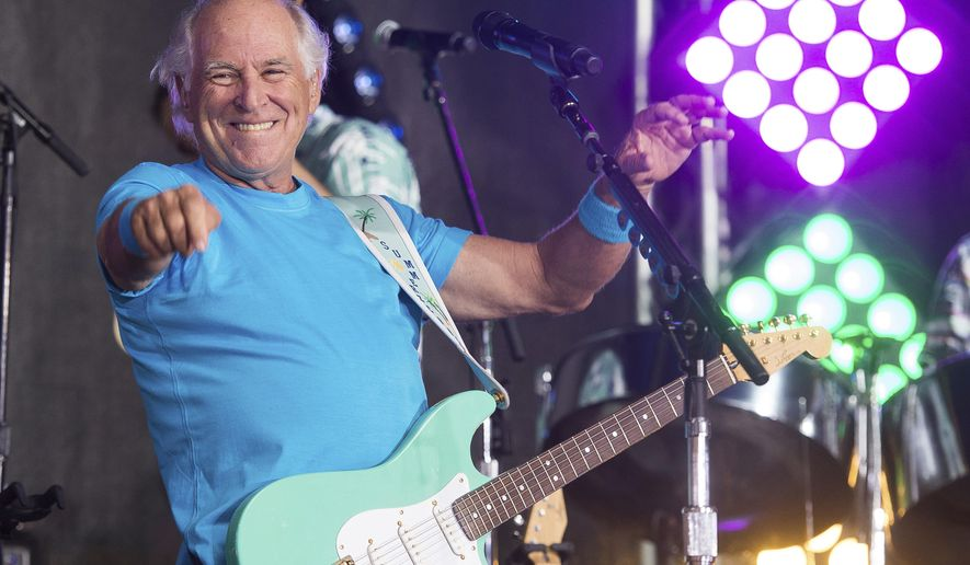"FILE - This July 29, 2016 file photo shows Jimmy Buffett performing on NBC's ""Today"" show in New York. The Jimmy Buffett musical will premiere in California and will make stops in New Orleans, Houston and Chicago before docking on Broadway by spring of 2018. ""Escape to Margaritaville,"" combining Buffett's tunes with an original story by writers Greg Garcia and Mike O'Malley, will start grooving onstage in May 2017 at La Jolla Playhouse. (Photo by Charles Sykes/Invision/AP, File)"