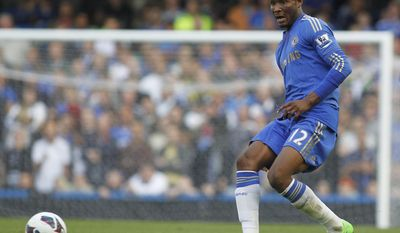 FILE - In this Sept. 22, 2012 file photo Chelsea's John Obi Mikel plays against Stoke City during their English Premier League soccer match at Stamford Bridge, London. John Obi Mikel has followed Chelsea midfielder Oscar to the Chinese Super League by leaving Stamford Bridge on Friday Jan. 6, 2017 to join Tianjin TEDA. (AP Photo/Sang Tan, File)