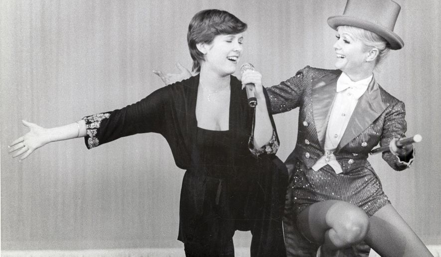 "This image released by HBO shows Carrie Fisher, left, and her mother Debbie Reynolds from the HBO documentary, ""Bright Lights: Starring Carrie Fisher and Debbie Reynolds,"" premiering Saturday, Jan. 7, 2017, at 8 p.m. ET/PT. (HBO via AP)"