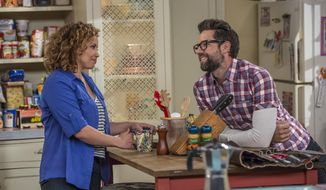 "This image released by Netflix shows Justina Machado, left, and Todd Grinnell in a scene from ""One Day At A Time."" The series,  a remake of the 1970's-80's Norman Lear TV series, centers on a Cuban-American family. It debuts on Netflix on Sunday. (Michael Yarish/Netflix via AP)"