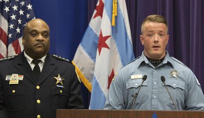 Chicago Police Officer Mike Donnelly, accompanied by Police Superintendent Eddie Johnson, left,  speaks at a news conference Thursday, Jan. 5, 2017, in Chicago. Johnson said four black people have been charged with hate crimes in connection with a video broadcast live on Facebook that showed an assault on a mentally disabled white man. Donnelly was one of the first officers on the scene. (AP Photo/Teresa Crawford)