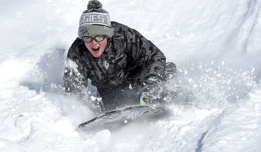 Luke Eubanks enjoys a day off from school while sledding at Hyrum Gibbons Park in Logan, Utah, Thursday, Jan. 5, 2017. Schools in Cache Valley were closed for the day after a snow storm. (Eli Lucero/The Herald Journal via AP)