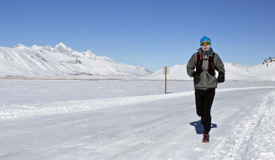 """In this Thursday, Jan. 4, 2017 photo, Walt Gerald braves sub-zero temperatures during his run at the National Elk Refuge near Jackson, Wyo. """"It's really not that bad once you get warmed up,"""" Gerald said. """"The ice on my face is a nice wind block."""" (Rugile Kaladyte/Jackson Hole News & Guide via AP)"""
