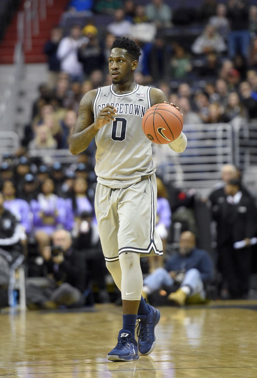 Georgetown guard L.J. Peak (0) dribbles the ball during the second half an NCAA college basketball game against Butler, Saturday, Jan. 7, 2017, in Washington. Butler won 85-76 in overtime. (AP Photo/Nick Wass) **FILE**