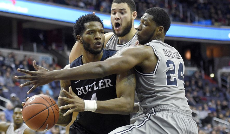 Butler forward Tyler Wideman, left, is pressured by Georgetown forward Marcus Derrickson (24) and center Bradley Hayes, rear, during the second half an NCAA college basketball game, Saturday, Jan. 7, 2017, in Washington. Butler won 85-76 in overtime. (AP Photo/Nick Wass)