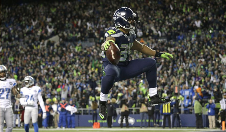 Seattle Seahawks running back Thomas Rawls celebrates after he rushed for a touchdown against the Detroit Lions in the second half of an NFL football NFC wild card playoff game, Saturday, Jan. 7, 2017, in Seattle. (AP Photo/Elaine Thompson)