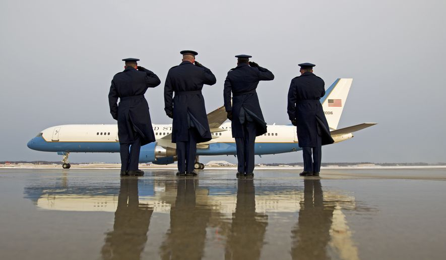 Military personnel salute as Air Force One with President Barack Obama aboard, departs at Andrews Air Force Base, Md., Saturday, Jan. 7, 2017, en route to Jacksonville, Fla., to attend a wedding. ( AP Photo/Jose Luis Magana)