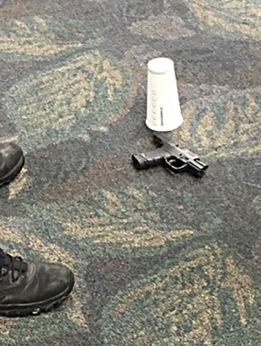 In this image taken Friday, Jan. 6, 2017 and made available by Mark Lea, shows the pistol of alleged shooter Esteban Santiago at the Ft. Lauderdale-Hollywood International Airport. Santiago opened fire in the baggage claim area killing five travelers. (Mark Lea via AP)
