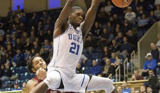 Duke's Amile Jefferson (21) dunks in front of Boston College's Mo Jeffers (15) during the first half of an NCAA college basketball game in Durham, N.C., Saturday, Jan. 7, 2017. (AP Photo/Ben McKeown)