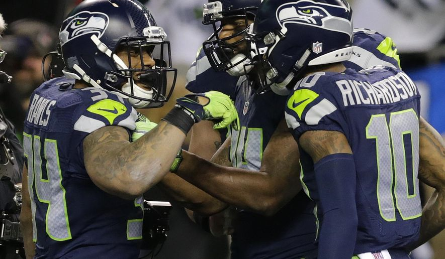 Seattle Seahawks running back Thomas Rawls, left, is greeted by wide receiver Paul Richardson, right, after Rawls scored a touchdown against the Detroit Lions in the second half of an NFL football NFC wild card playoff game, Saturday, Jan. 7, 2017, in Seattle. (AP Photo/Stephen Brashear)