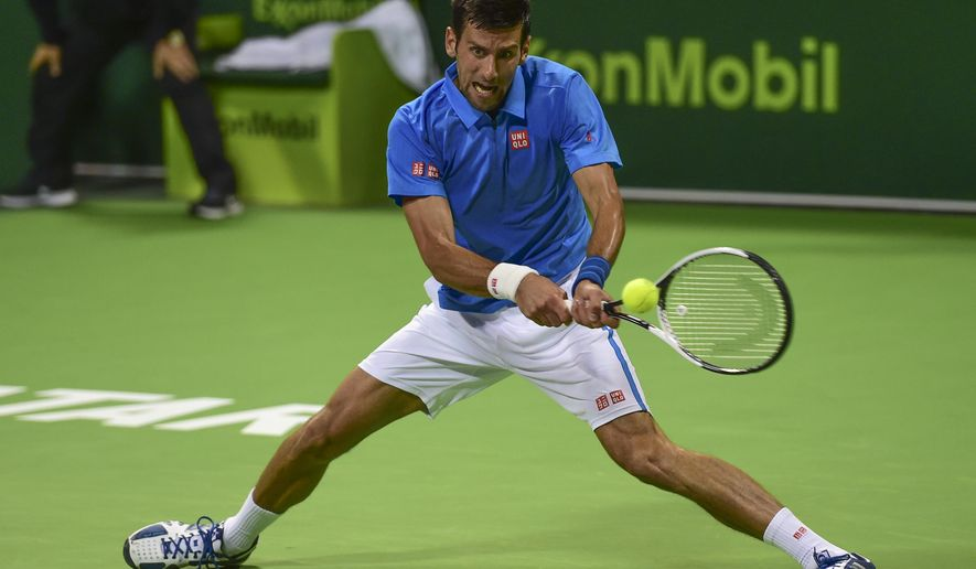 Novak Djokovic of Serbia returns the ball to Britain's Andy Murray during the Qatar Open 2017 final tennis match in Doha, Qatar, Saturday, Jan. 7, 2017. (AP Photo/Alexandra Panagiotidou)