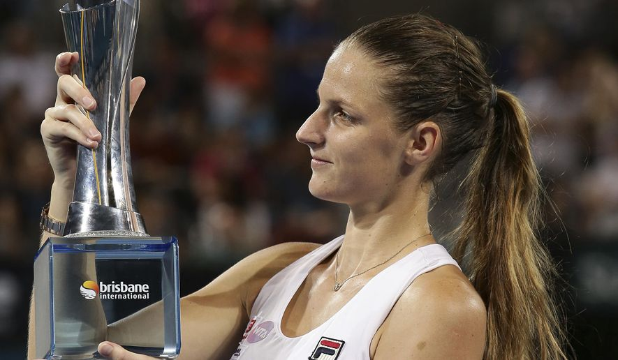 Karolina Pliskova of the Czech Republic poses with the trophy after winning the final match against Alize Cornet of France 6-1, 6-3 at the Brisbane International tennis tournament in Brisbane, Australia, Saturday,  Jan. 7, 2017. (AP Photo/Tertius Pickard)