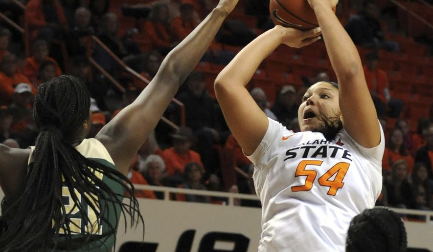 Baylor guard Alexis Jones (30) watches as Oklahoma State center Kaylee Jensen (54) takes a shot over the defense of Baylor guard Kalani Brown (21) during an NCAA college basketball game in Stillwater, Okla., Satruday, Jan. 7, 2017. (AP Photo/Brody Schmidt)