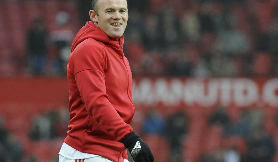 Manchester United's Wayne Rooney warms up ahead of during the English FA Cup Third Round match between Manchester United and Reading at Old Trafford in Manchester, England, Saturday, Jan. 7, 2017. (AP Photo/Rui Vieira)
