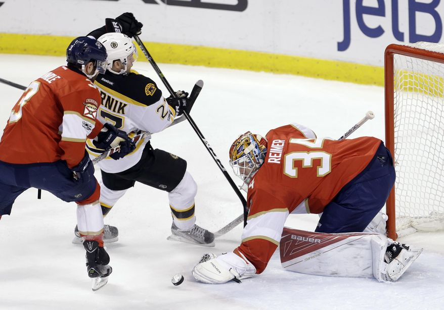 Florida Panthers goalie James Reimer (34) stops a shot as Keith Yandle (3) defends against Boston Bruins center Austin Czarnik (27) in the first period of an NHL hockey game, Saturday, Jan. 7, 2017, in Sunrise, Fla. (AP Photo/Alan Diaz)