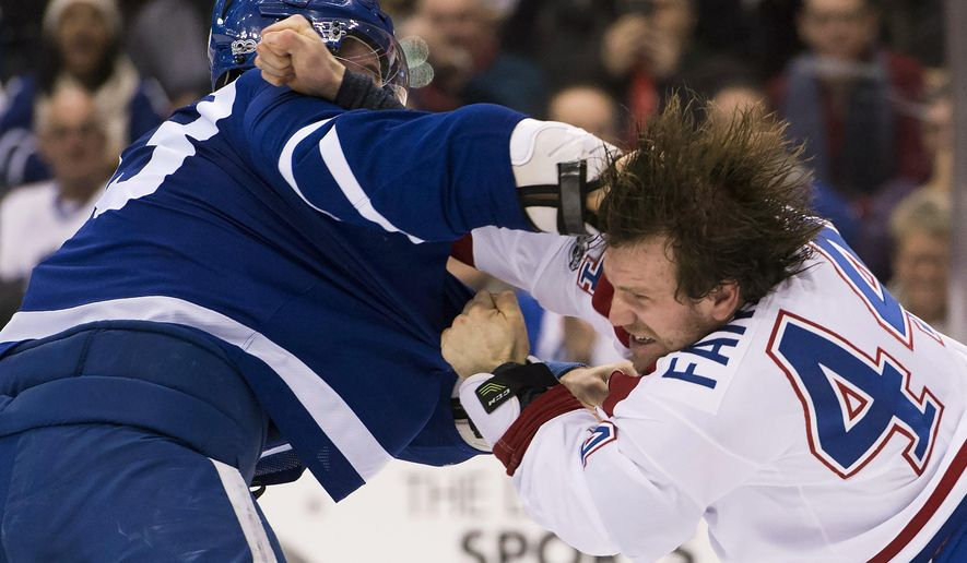 Toronto Maple Leafs center Frederik Gauthier (33) scuffles with Montreal Canadiens right wing Bobby Farnham (44) during the second period of an NHL hockey game in Toronto on Saturday, Jan. 7, 2017. (Nathan Denette/The Canadian Press via AP)