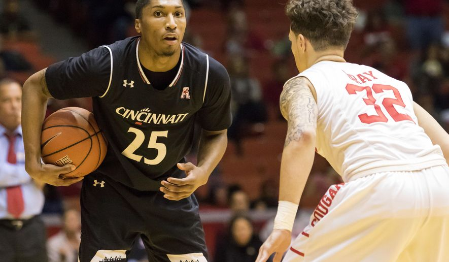 Cincinnati's Kevin Washington (25) holds the ball on the perimeter while being defended by Houston's Rob Gray (32) in the second half of an NCAA college basketball game Saturday, Jan. 7, 2017, in Houston. (AP Photo/Joe Buvid)