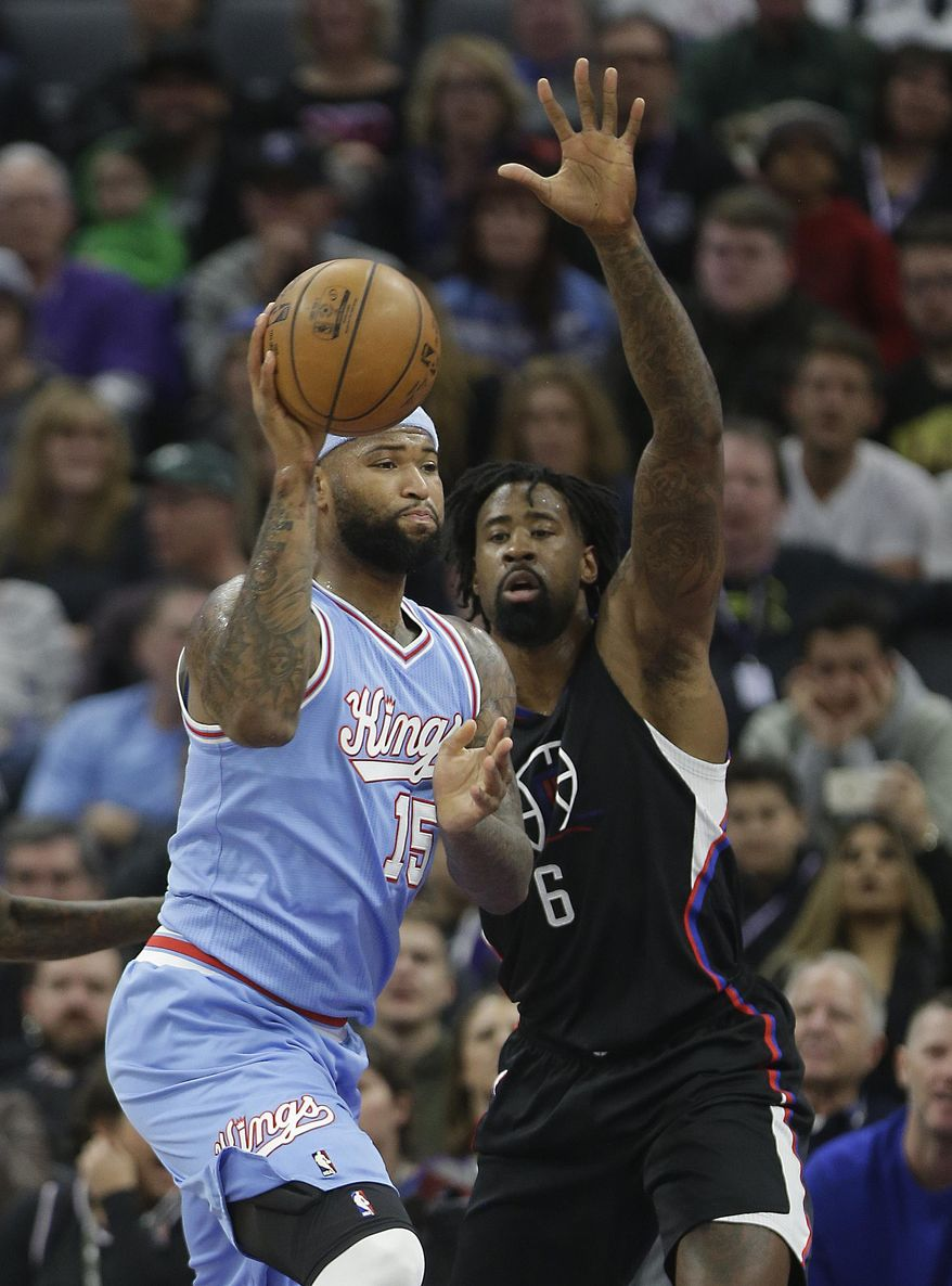 Sacramento Kings forward DeMarcus Cousins, left, passes against Los Angeles Clippers center DeAndre Jordan during the first half of an NBA basketball game Friday, Jan. 6, 2017, in Sacramento, Calif.(AP Photo/Rich Pedroncelli)