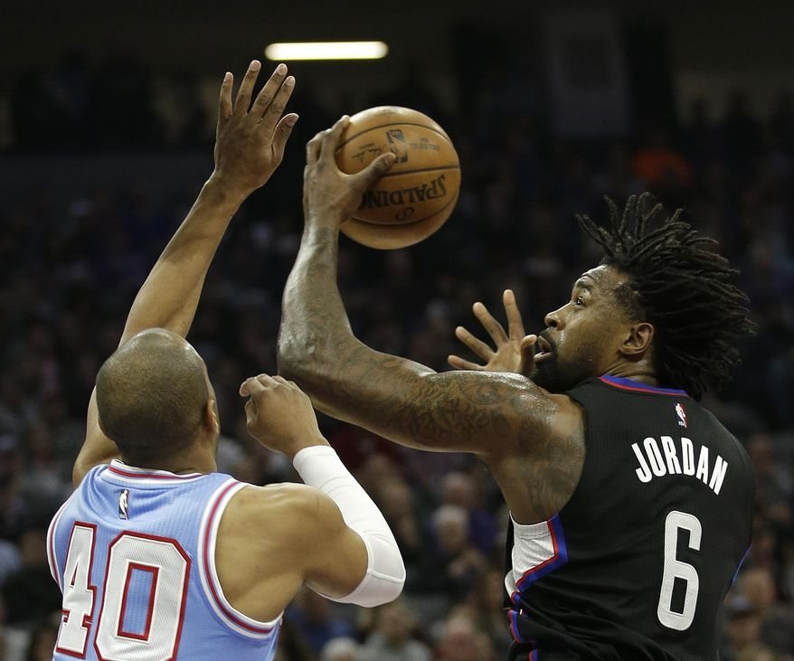 LA Clippers center DeAndre Jordan, right, goes to the basket against Sacramento Kings guard Arron Afflalo during the first half of an NBA basketball game Friday, Jan. 6, 2017, in Sacramento, Calif. (AP Photo/Rich Pedroncelli)