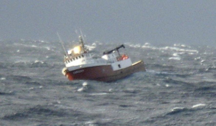 In this Friday, Jan. 6, 2017, photo released by the U.S. Coast Guard, the fishing vessel Lady Gudny is adrift in heavy seas east of Kodiak, Alaska. The Coast Guard says several people have been safely airlifted from the disabled fishing vessel Friday. (Bill Colclough/U.S. Coast Guard via AP)
