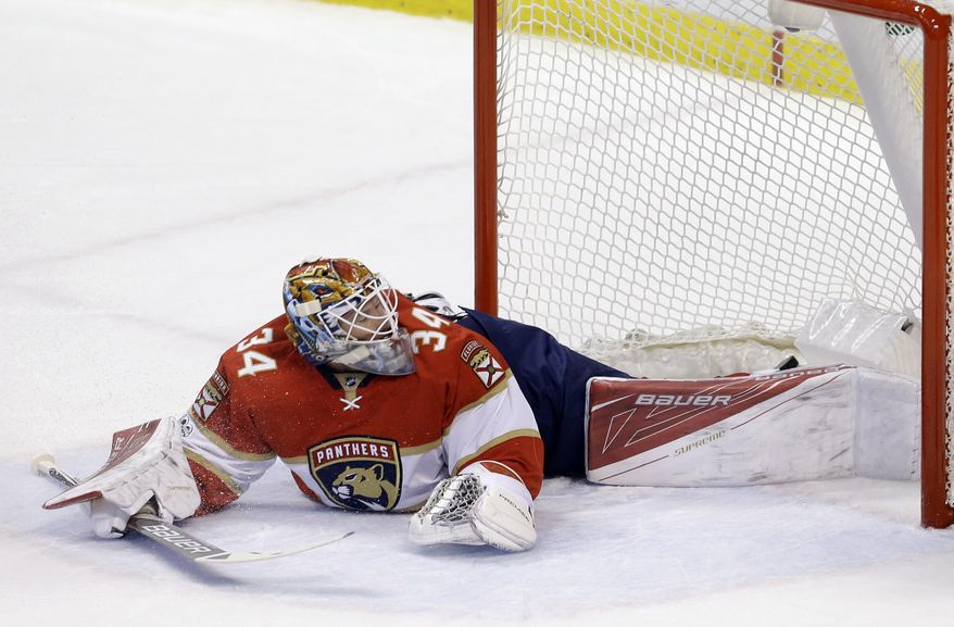 RETRANSMISSION TO CORRECT YEAR - Florida Panthers goalie James Reimer (34) is unable to stop a shot by Boston Bruins left wing Brad Marchand (63) in the first period of an NHL hockey game in Saturday, Jan. 7, 2017 in Sunrise, Fla. (AP Photo/Alan Diaz)