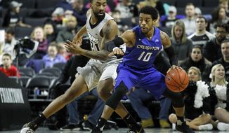 Providence's Jalen Lindsey (21) defends as Creighton's Mo Watson (10) works the ball during the first half of an NCAA college basketball game Saturday, Jan. 7, 2017, in Providence, R.I. (AP Photo/Stew Milne)