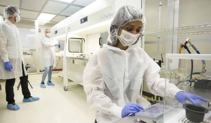 In this Nov. 13, 2016 photo, from left, researchers Steven Guenthner, Therese Montano and Sahaja Patel prepare items inside the Vivorte labs  in Louisville, Ky. The start-up creates a bone cement mixture that uses small bone fragments, shaped like tiny bow ties, to fill the spaces in between broken bones, creating a more efficient highway of bone healing that is more easily resorbed into the body.    (Alton Strupp/The Courier-Journal via AP)