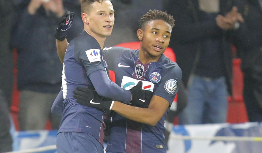 PSG's Julian Draxler, left, celebrates with his teammate Christopher Alan Nkunku after scoring 7- 0 during a French Cup soccer match Paris Saint-Germain against Bastia at Parc des Princes stadium in Paris, Saturday, Dec. 7, 2017. (AP Photo/Michel Euler)