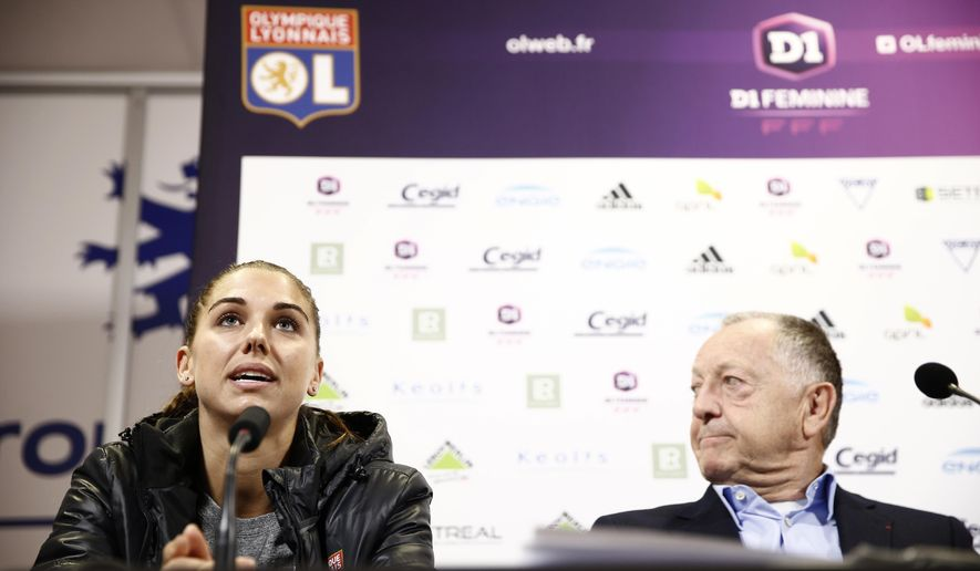United States' Alex Morgan, left, and Lyon's soccer club President Jean-Michel Aulas, attend a press conference as part of her official presentation in Lyon, central France, Saturday, Jan. 7, 2017. Morgan signed a half-season contract with reigning European champion Olympique Lyon. (AP Photo)