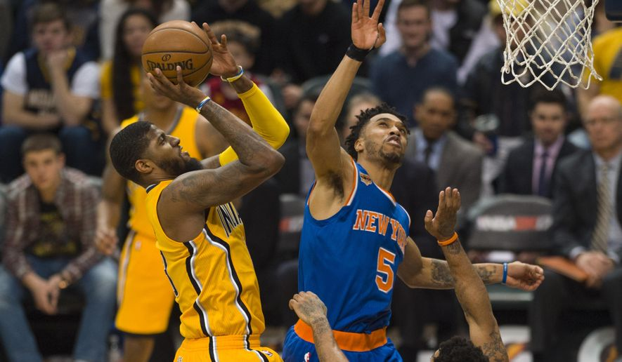 Indiana Pacers forward Paul George (13) shoots as New York Knicks guard Courtney Lee (5) tries to block during the second half of an NBA basketball game, Saturday, Jan. 7, 2017, in Indianapolis. (AP Photo/Doug McSchooler)