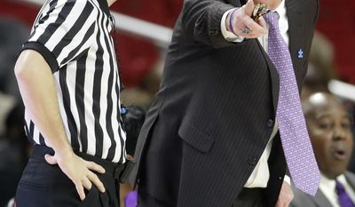 Northwestern head coach Joe McKeown, right, speaks with a referee in the first half of an NCAA college basketball game against Maryland, Saturday, Jan. 7, 2017, in College Park, Md. (AP Photo/Patrick Semansky)