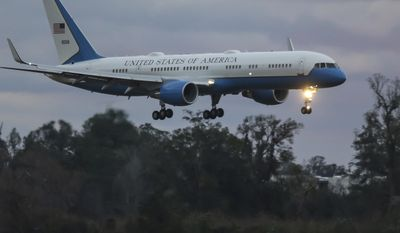 Air Force One arrives at Jacksonville International Airport on Saturday, Jan. 7, 2017, in Jacksonville, Fla. (AP Photo/Gary McCullough)