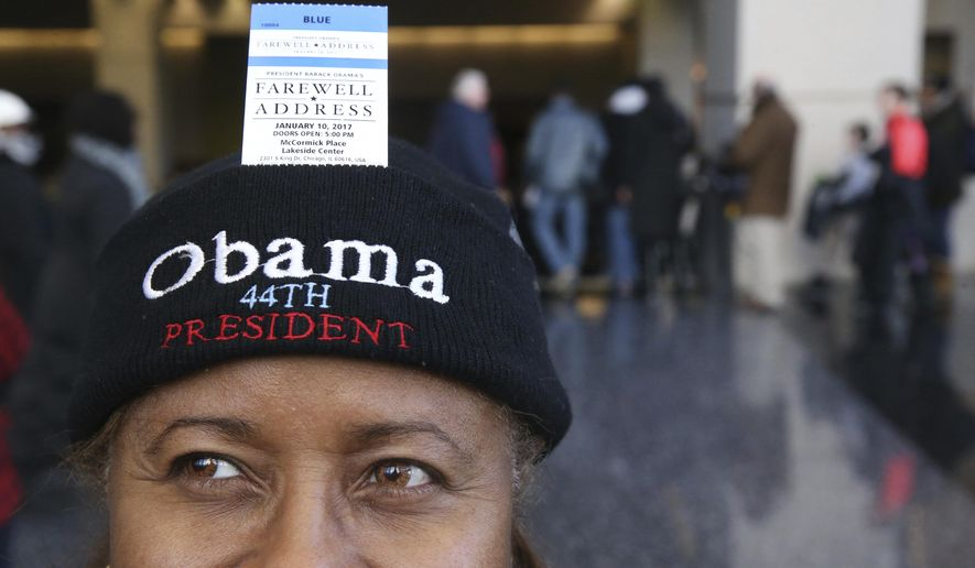 Sheryl Harvey is shown with her ticket to President Barack Obama's final scheduled speech on Saturday, Jan. 7, 2017 in Chicago.   Thousands of people have lined up in frigid temperatures hoping for tickets. Obama plans to speak to supporters Tuesday night, carrying on a tradition set in 1796 when George Washington addressed the American people for the last time as president.  (Chris Sweda/Chicago Tribune via AP)