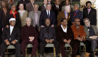 FILE - In this Friday, Jan. 13, 2006 file photo, Jazz legends pose for a group portrait of National Endowment for the Arts Jazz Masters of the past and present, in New York. At foreground right is writer Nat Hentoff. His son, Tom Hentoff, said his father died on Saturday, Jan. 7, 2017, from natural causes at his Greenwich Village apartment. He was 91. Also in the photo are, from left, front row: Clark Terry, Frank Foster, James Moody, Chico Hamilton, Roy Haynes and jazz writer Nat Hentoff; middle row: John Levy, Nancy Wilson, Chick Corea, Barry Harris, Tony Bennett, Jim Hall, Slide Hampton and David Baker; top row: Ron Carter, Bob Brookmeyer, Ray Barretto, Buddy DeFranco, Paquito D'Rivera, McCoy Tyner and Freddie Hubbard. (AP Photo/Bebeto Matthews)