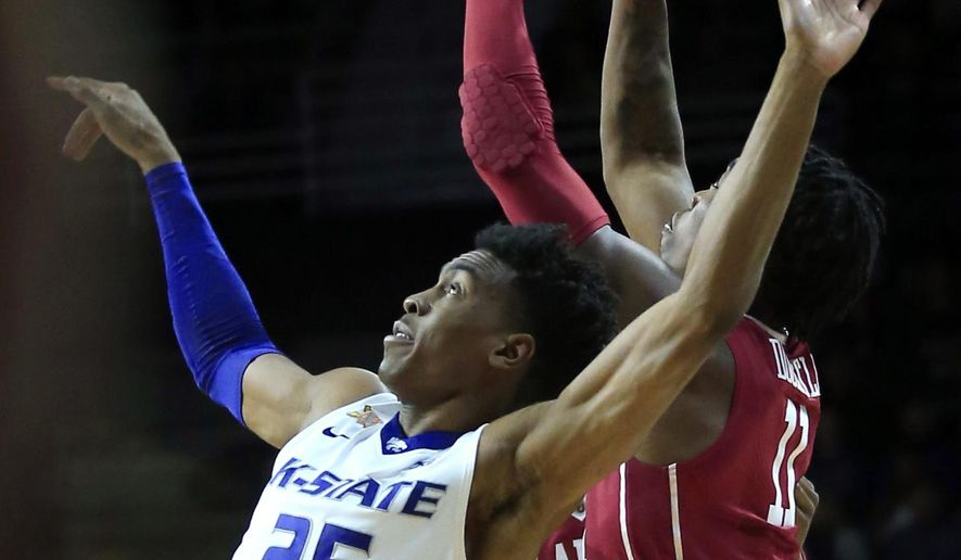Oklahoma forward Kristian Doolittle (11) gets to a free ball ahead of Kansas State forward Wesley Iwundu (25) during the first half of an NCAA college basketball game in Manhattan, Kan., Saturday, Jan. 7, 2017. (AP Photo/Orlin Wagner)