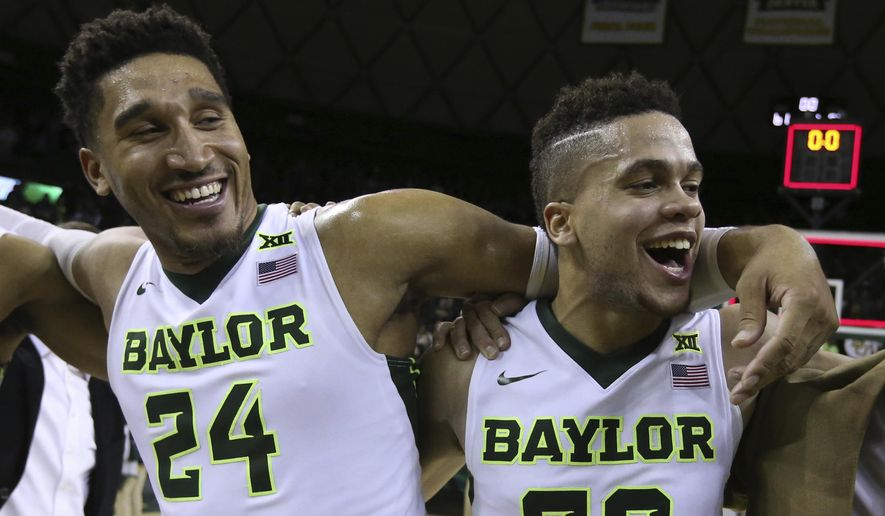 Baylor guard Ishmail Wainright, left, and guard Manu Lecomte, right celebrate following their game with Oklahoma State after an NCAA college basketball game, Saturday, Jan. 7, 2017, in Waco, Texas. Baylor won 61-57. (AP Photo/Rod Aydelotte)