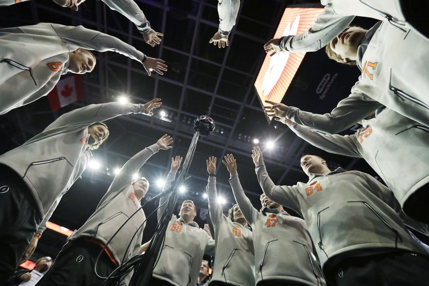 Clemson players pose for a 360 degree camera during media day for the NCAA college football playoff championship game against Alabama Saturday, Jan. 7, 2017, in Tampa, Fla. (AP Photo/David J. Phillip)